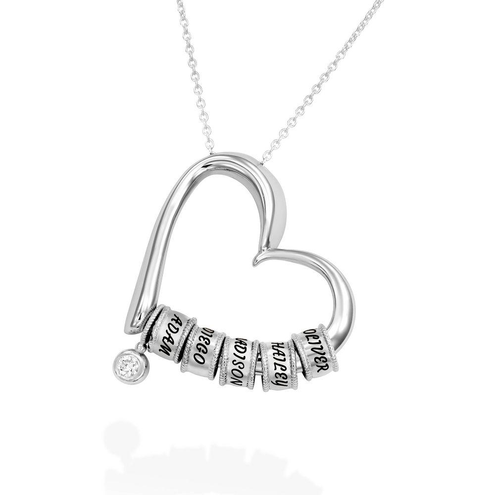 Charmevolle Herz-Halskette mit eingravierten Perlen und Diamant aus Sterlingsilber