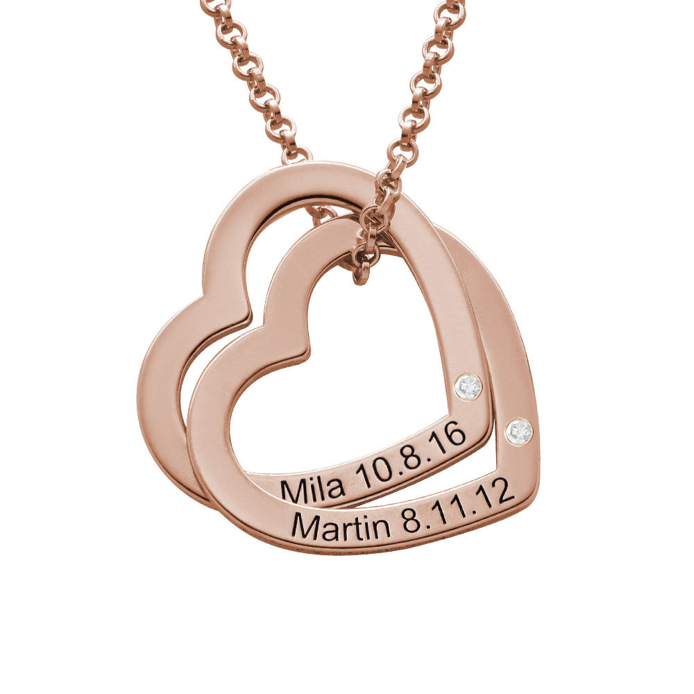 Sammenflettede hjertehalskæde i 18 karat rosaforgyldt sterling sølv med diamanter