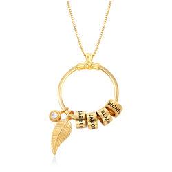 Linda amilie halskæde med indgraverede vedhæng og blad i guld produkt billede