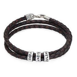 Flettet brunt læderarmbånd til mænd med graverede sølvringe produkt billede