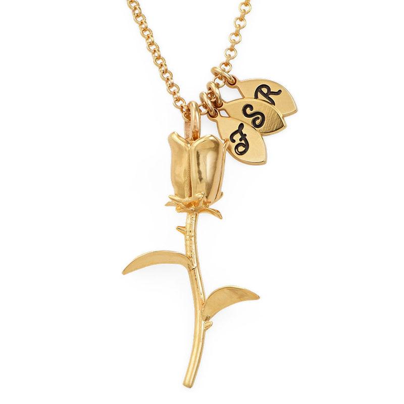 Collier avec rose et pendentif avec lettre en plaqué or