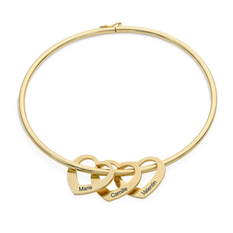 Bracelet jonc avec pendentifs cœur en plaqué or