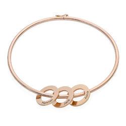 Bracelet jonc avec pendentifs ronds en plaqué or rose photo du produit