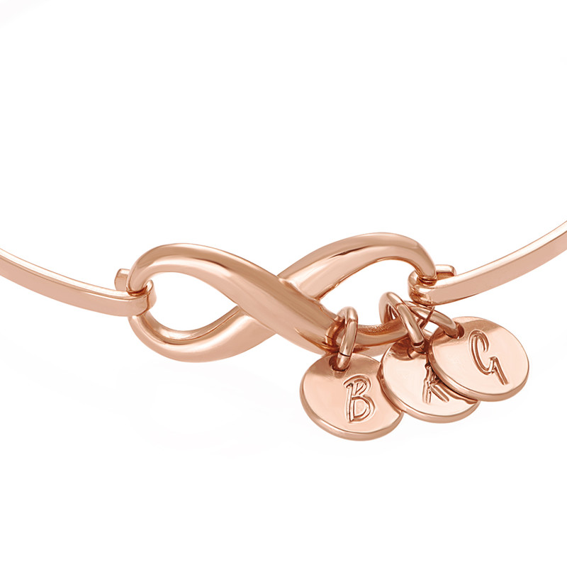 Infinity Bangle Bracelet with Initial Charms in Rose Gold Plating - 1