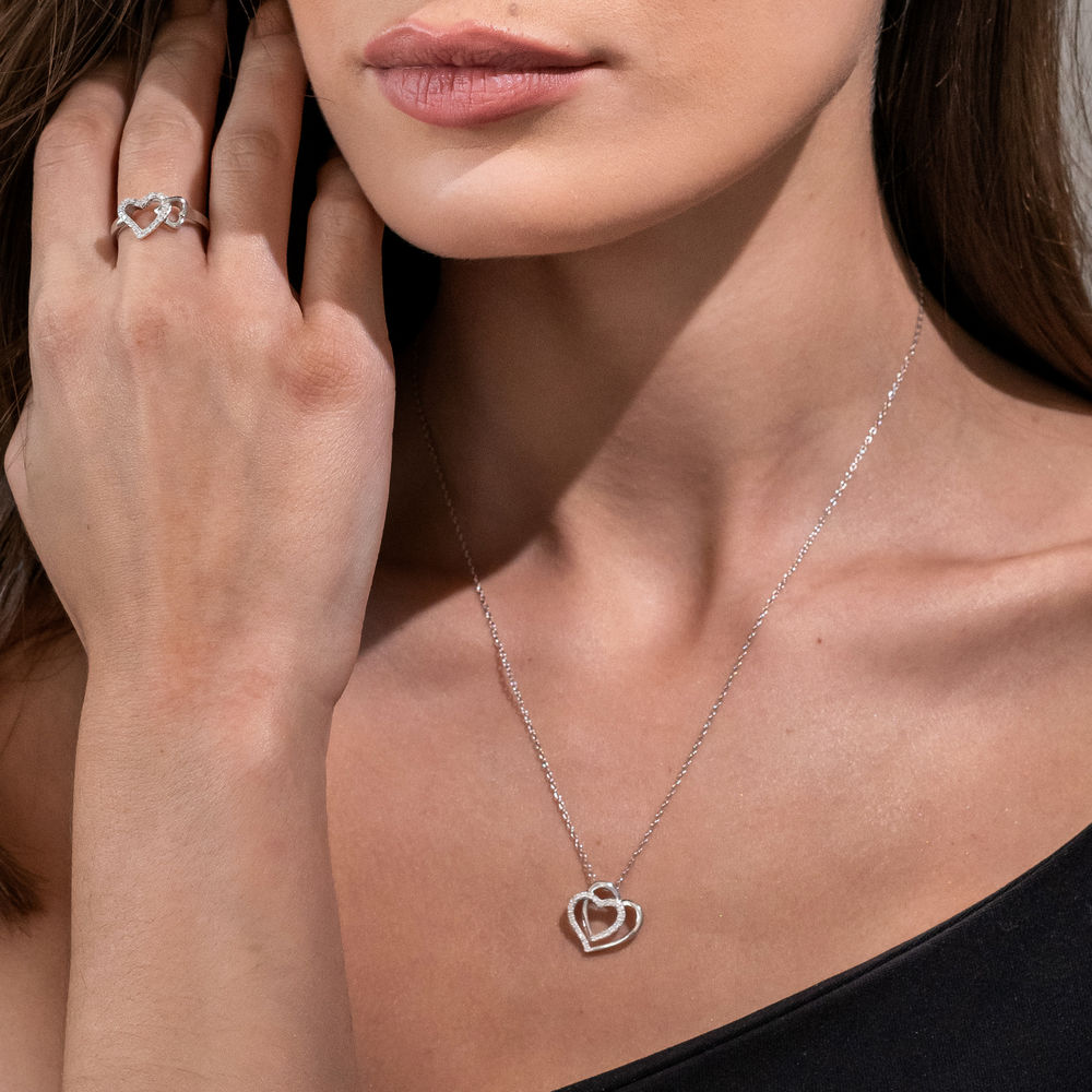 1/10 CT. T.W. Diamond Doble Heart Pendant in Sterling Silver - 2