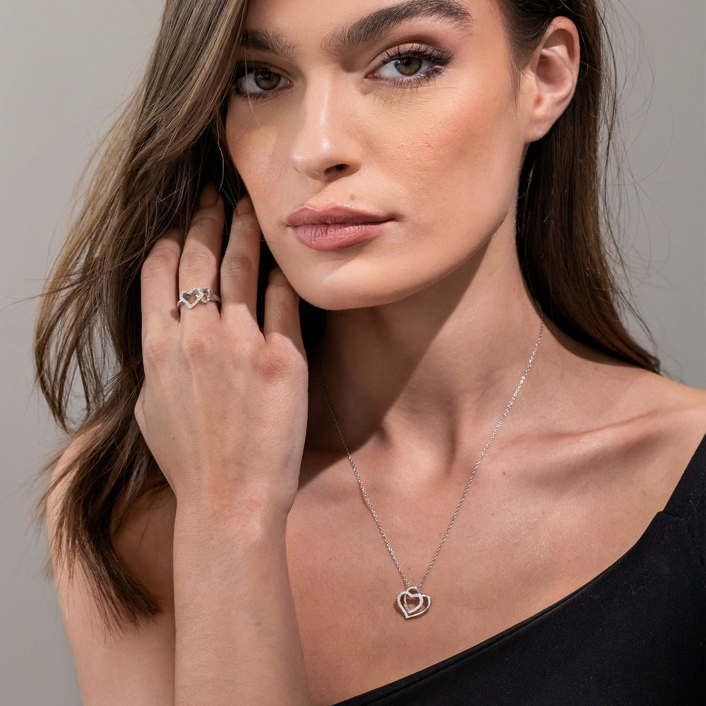 1/10 CT. T.W. Diamond Doble Heart Pendant in Sterling Silver - 3