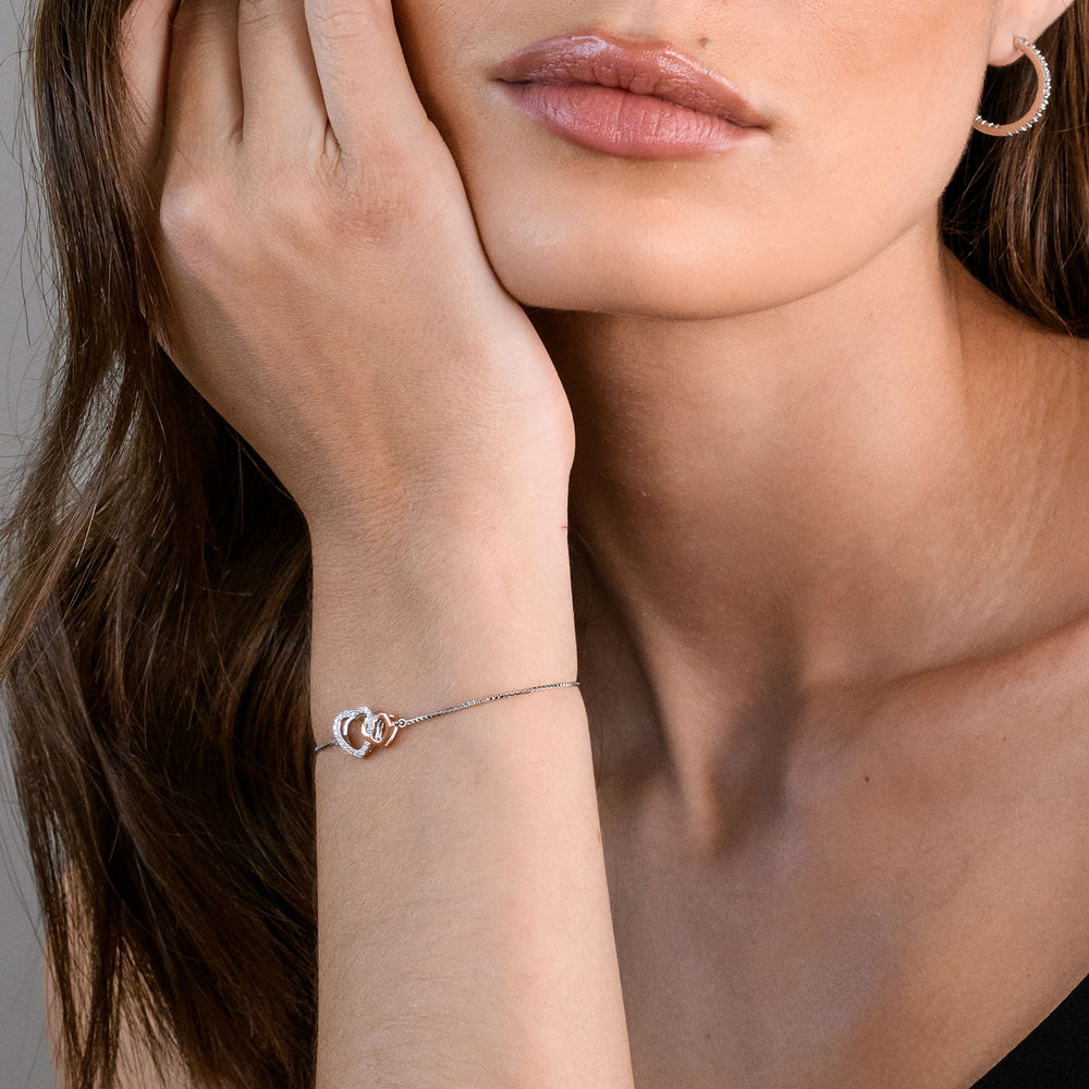 1/10 CT. T.W. Diamond Interlocked Hearts Bolo Bracelet in Sterling Silver and Rose Gold Plated - 2