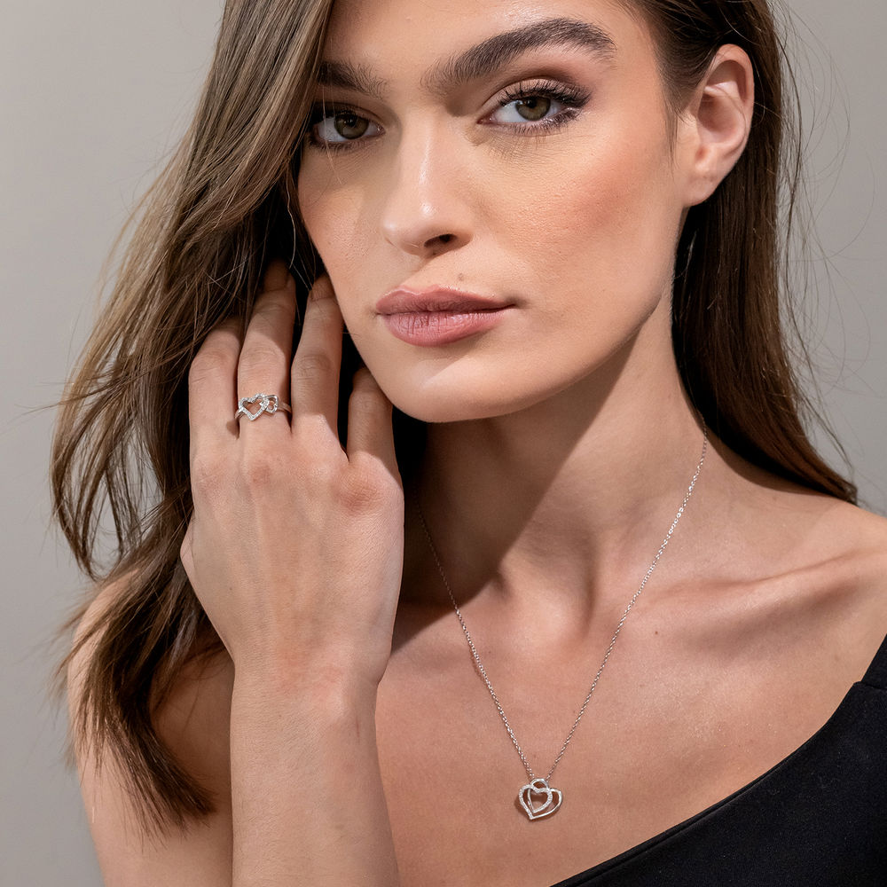 1/10 CT. T.W. Diamond Interlocked Hearts Ring in Sterling Silver - 3