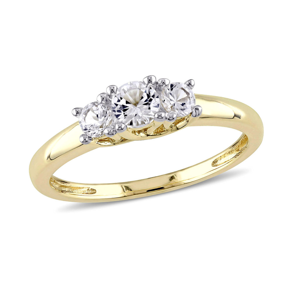 5/8 C.T T.G.W. Lab-grown White Sapphire 3-Stone Ring in 10K Yellow Gold