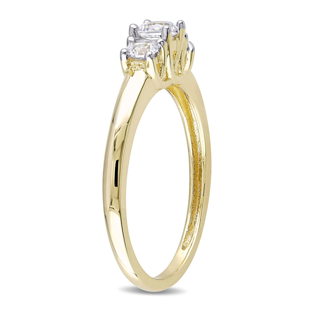 5/8 C.T T.G.W. Lab-grown White Sapphire 3-Stone Ring in 10K Yellow Gold - 1