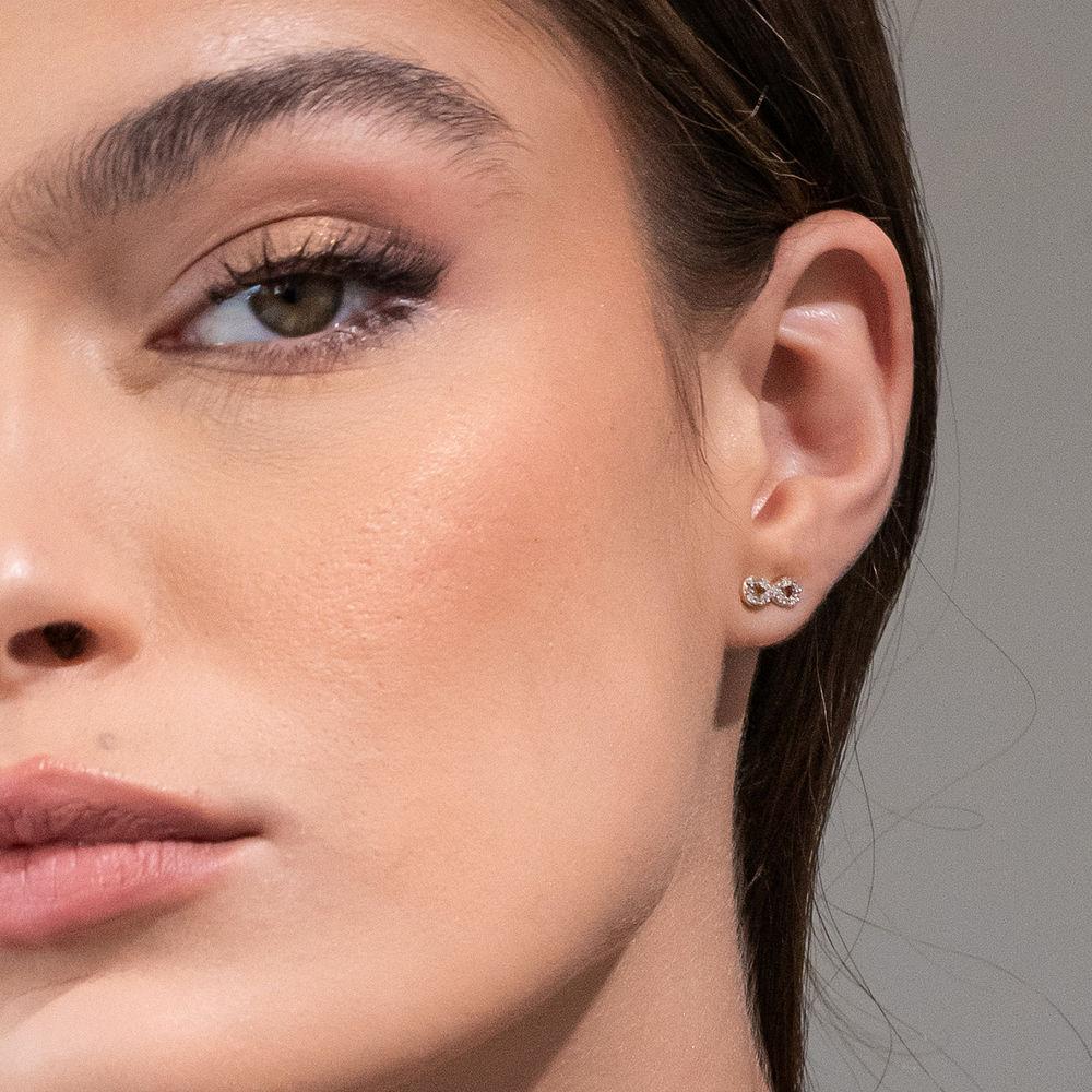 1/10 CT. T.W. Diamond Infinity Stud Earrings in 10k Yellow Gold - 2