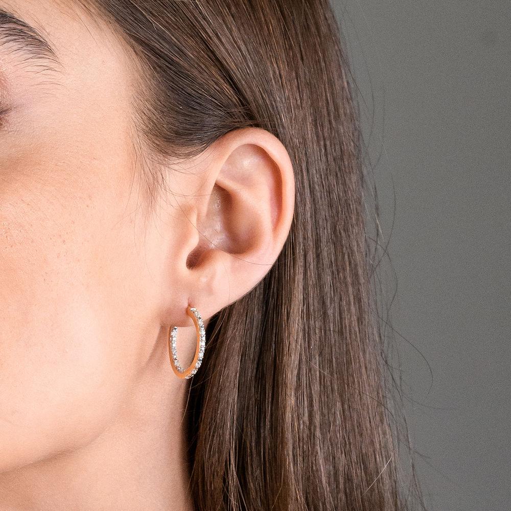 1/4 CT. T.W. Diamond Inside-Out Hoop Earrings in Gold Plated Sterling Silver - 1