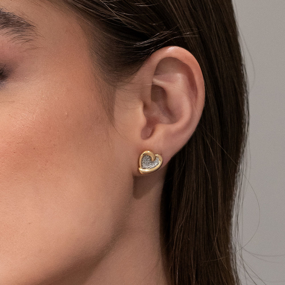 1/6 CT. T.W. Diamond Heart Stud Earrings in Gold Plated Sterling Silver - 1