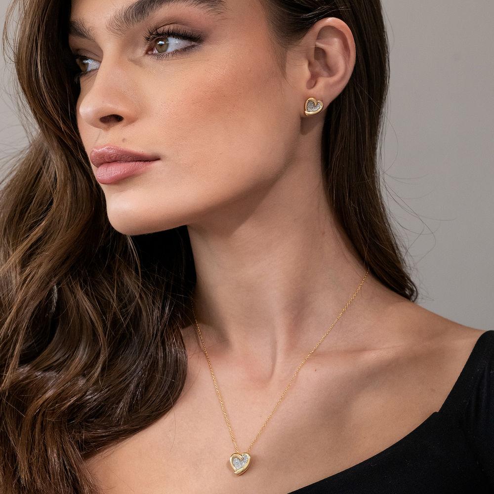 1/6 CT. T.W. Diamond Heart Stud Earrings in Gold Plated Sterling Silver - 2