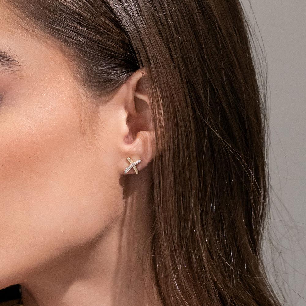 1/10 CT. T.W. Diamond X Stud Earrings in 10k Yellow Gold - 1