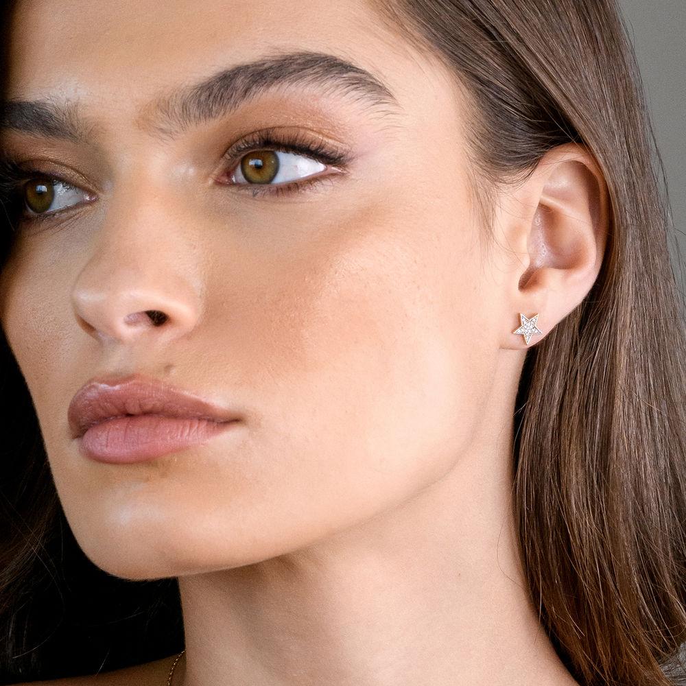 1/10 CT. T.W. Diamond Star Stud Earrings in 10k Yellow Gold - 1