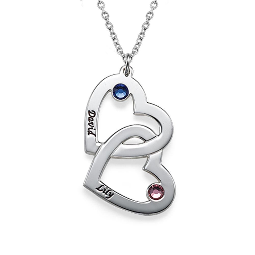 Collana con coppia di cuori in argento e pietre portafortuna
