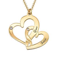 Gullbelagt inngravert smykke med to hjerter og diamanter produktbilde