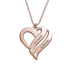 Halskjede med to hjerter og diamanter i rosegullbelegg produktbilde
