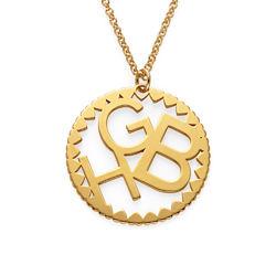 Rundt smykke med bokstaver i gullbelegg produktbilde