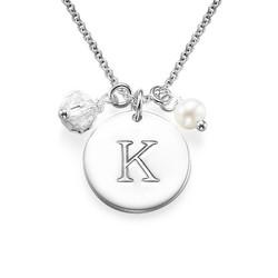 Bokstavsmykke med charms i sølv produktbilde