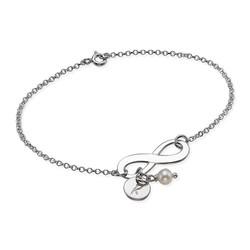 Evighetsarmbånd med bokstav og perle i sølv produktbilde