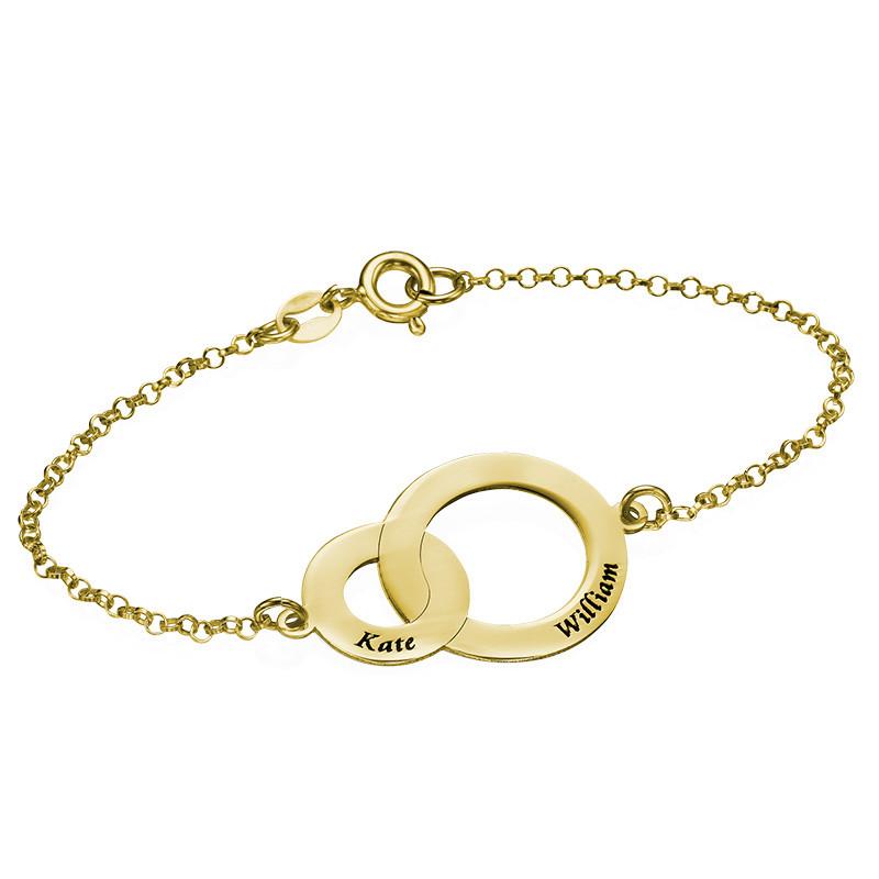 Armband med två sammansatta cirklar i 18 karat guldplätering