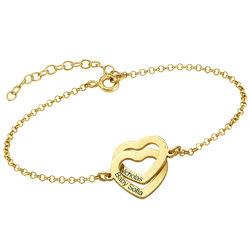Armband med sammanflätade hjärtan i 18K guldplätering produktbilder