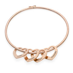 Bangle Bracelet with Heart Shape Pendants in Rose Gold Plating product photo